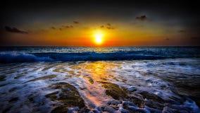 Memorable ending. Sun setting over violent sea Stock Image