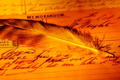 Memorandum. Feather and a Memorandum With Creative Lighting.  See Portfolio For Similar Concepts Royalty Free Stock Photography