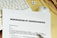 Memorandum of understanding concept. With manila envelpo and laptop computer Stock Images