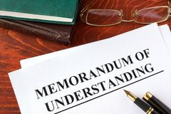 Memorandum of understanding MOU. Memorandum of understanding MOU on a table and a pen Stock Image