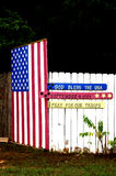 Memorative Patriotic Message. Commemorative patriotic message painted in red, white and blue on a white fence stock photos