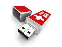 Memoria USB de los primeros auxilios en el fondo blanco Imágenes de archivo libres de regalías