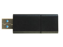 Memoria USB negra en el fondo blanco Fotografía de archivo libre de regalías