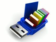Memoria USB y libros en el fondo blanco Fotografía de archivo libre de regalías