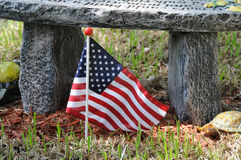 Memorial. United States flag marking loss of military with flowers Royalty Free Stock Image