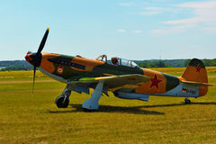 Memorial Airshow. Aircraft Jak-9 in aviation fair and century air combats. Stock Photo