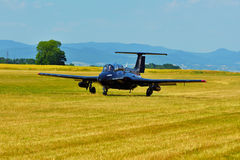 Memorial Airshow.   Czech L29 advanced jet traning aircraft. Landing at a grassy airport. Stock Images