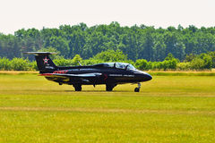 Memorial Airshow.   Czech L29 advanced jet traning aircraft. Landing at a grassy airport. Royalty Free Stock Image