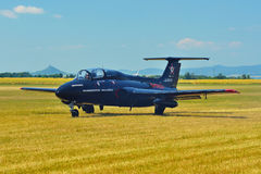 Memorial Airshow.   Czech L29 advanced jet traning aircraft. Landing at a grassy airport. Royalty Free Stock Photo