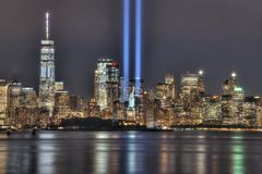 9/11 Memorial Beams with Statue of Liberty Between Them and Lower Manhattan.  royalty free stock images