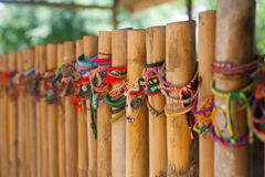 Memorial bracelet on Wooden Sticks in Cambodian Holocaust Memorial Site close to Phnom Pehn Royalty Free Stock Photo