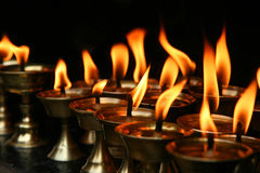 Memorial Candles. Burning inside dark temple Nepal royalty free stock photos