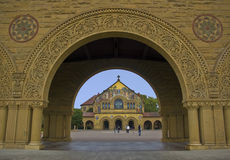 Memorial Chapel at Stanford University. This is a picture of the Memorial Chapel at Stanford University framed by an arch of the Quad, the university quadrangle Royalty Free Stock Photography
