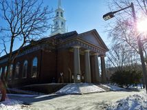 Memorial Church at Harvard University in Cambridge with sun in a view. Photo of the Memorial Church at Harvard University in Cambridge, MA, USA with sun in a Royalty Free Stock Images
