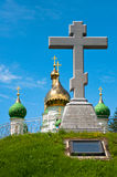 Memorial cross on the background of the church. Memorial cross on a background of church domes. Day, summer royalty free stock photography