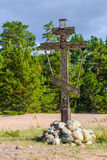 Memorial cross in the Russian wood. And rocks Royalty Free Stock Images