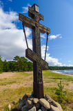 Memorial cross in the Russian wood. And rocks Royalty Free Stock Image