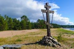 Memorial cross in the Russian wood. And rocks Stock Image