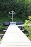 Memorial cross at waterfall Gremyachiy key. Royalty Free Stock Photos