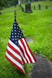 Memorial Day. American flag on grave of a veteran royalty free stock image