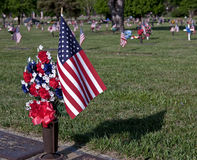 Memorial Day American Flag. Memorial Day flag and flowers by veterans grave Royalty Free Stock Image