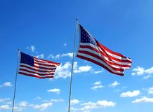 Memorial day. American flag flying in the blue sky Royalty Free Stock Photography