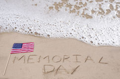 Memorial day background. On the sandy beach near ocean Royalty Free Stock Photography