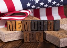 Memorial Day Banner. With a wooden cross and the American flag in background Stock Photo