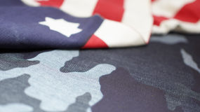 Memorial Day Camouflage Background and Usa Flag. Memorial Day Camouflage Background and Usa Flag in Shifting Focus Stock Images