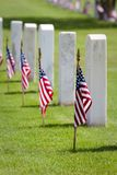 Memorial Day Cemetery. American flags on gravesites commemorate Memorial Day at at United States national cemetery royalty free stock photo