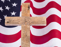 Memorial Day Cross and Flag. Memorial Day wooden cross over an American flag Royalty Free Stock Photos