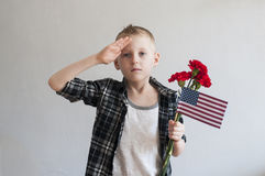 Memorial day with flowers and American flag Stock Photo