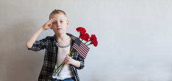 Memorial day with flowers and American flag Stock Image