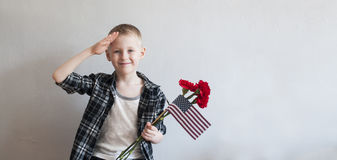 Memorial day with flowers and American flag Royalty Free Stock Images