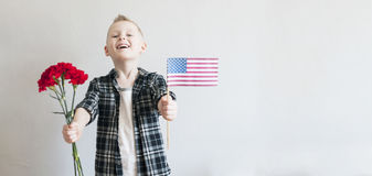 Memorial day with flowers and American flag Royalty Free Stock Photos