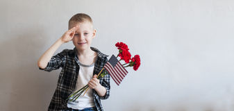 Memorial day with flowers and American flag Royalty Free Stock Photography