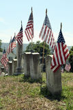Memorial Day Image. A view of the military section of a historical graveyard depicts the perfect Memorial Day or Veterans Day image - flags and military grave Royalty Free Stock Image