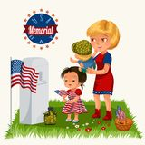 Memorial Day, mother with child cemetery, little girl lays flowers on grave war veteran, family Wife with children. Honoring memory fallen heroes, military Royalty Free Stock Image