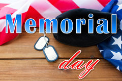 Memorial day over american flag, hat and dog tag Royalty Free Stock Images