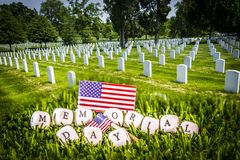 Memorial day phrase and grave stones. Great for Memorial Day. Grave stones in a row with memorial day phrase formed by wooden letters stock photography