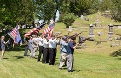 Memorial Day Salute. US military veterans shooting guns to salute fallen heroes in Michigan cemetary Stock Photos