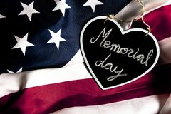 Memorial day text in black heart, on united states flag. Overhead picture of black heart including the text Memorial day inside, on united states flag royalty free stock image