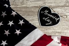 Memorial day text in black heart and united states flag. Overhead picture of united states flag and black heart including the text Memorial day inside, all over royalty free stock image
