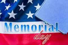 Memorial day words over american flag and book Royalty Free Stock Photo