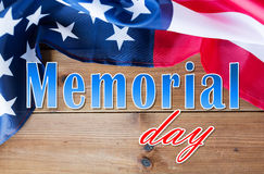 Memorial day words over american flag on wood Stock Photography
