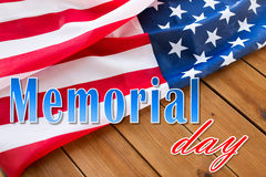 Memorial day words over american flag on wood Royalty Free Stock Image