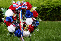Memorial Day Wreath. And robbon amonst grass and bushes royalty free stock images