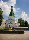 Memorial with an eternal flame and Archangel Michael Cathedral. Stock Photography