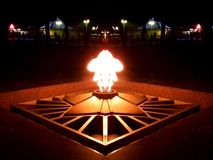 Memorial eternal flame. In the form of stars in city at night stock images