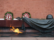 Memorial Eternal Flame Moscow Russia. A memorial eternal flame at the tomb of the unknown soldier outside the Kremlin wall in Moscow Russia Royalty Free Stock Images